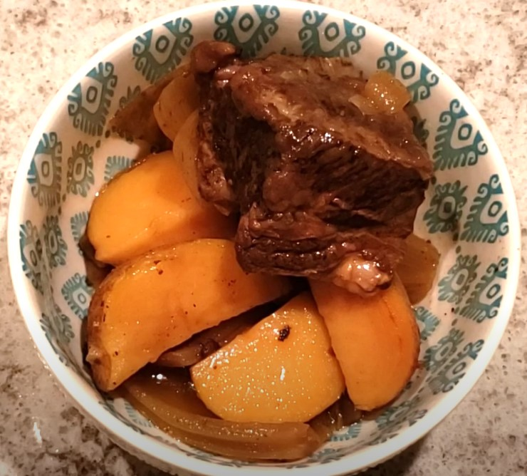 Slow cookedPrimal Butcher short ribs with potatoes in a bowl.