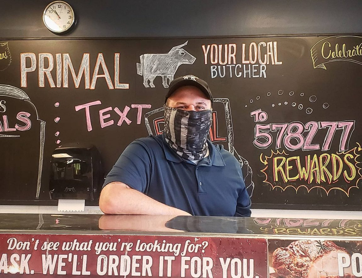 Primal employee wearing a mask
