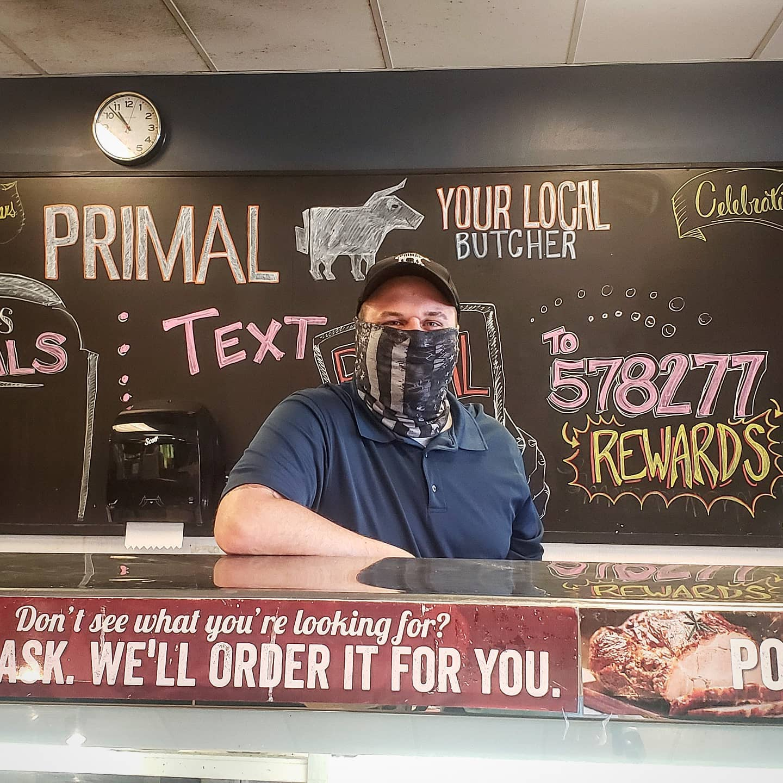 Primal employee wearing a mask